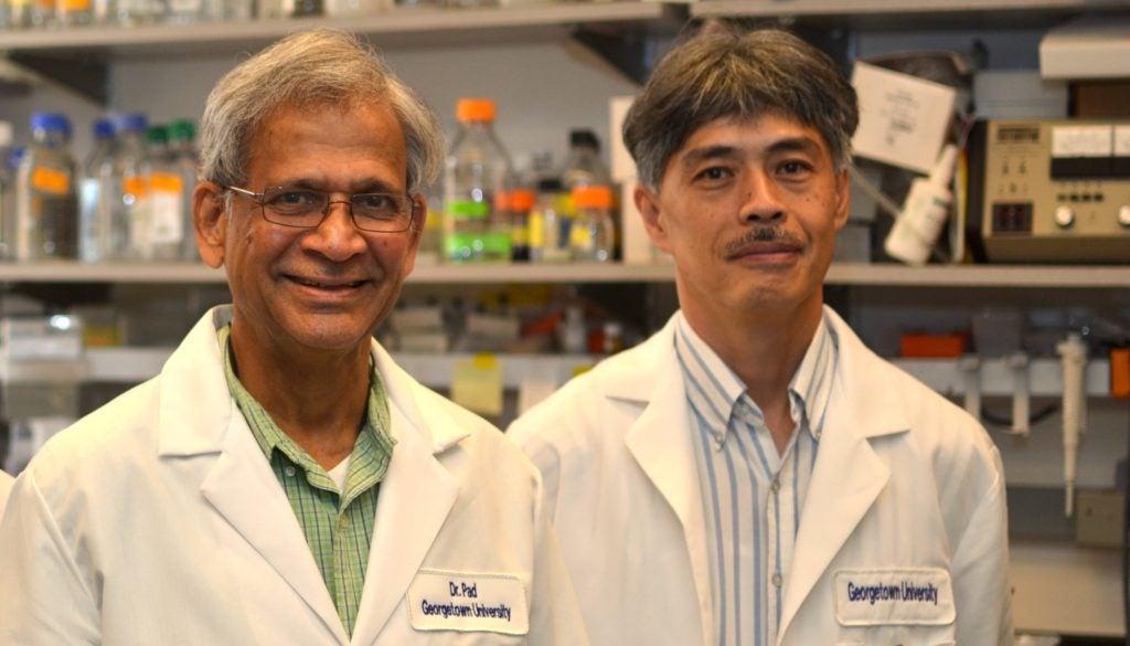 Dr. Padmanabhan (left) with lab Associate Dr. Tadahisa Teramoto (right)
