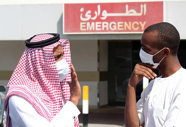 Two men in masks outside a MERS treatment facility in Saudi Arabia